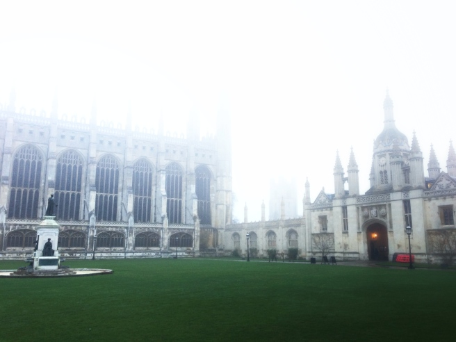 The seven rowers who've abandoned their duvets for eight o'clock in December, half-mummified in college-branded tracksuits against the freezing fog, mill around King's Front Court stamping and blowing under the sombre, ghostly gaze of Henry VI